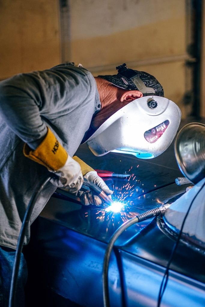 Adult Welding on Car